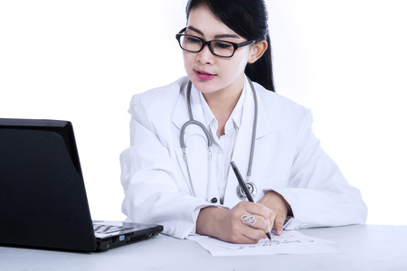 doctor writing: Female doctor writes medical reports - isolated on white background