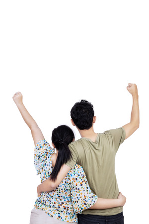 Back view of young couple expressing success. isolated on white background photo