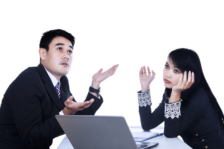 A business woman and man working together with a laptop isolated on white photo