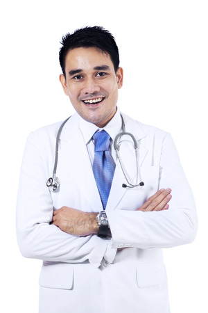 filipino adult: Portrait of smiling young doctor. Isolated on white background  Stock Photo