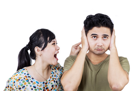 indonesian: Unhappy young couple having an argument. isolated on white Stock Photo
