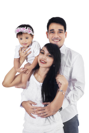 Portrait of happy asian family on white background photo
