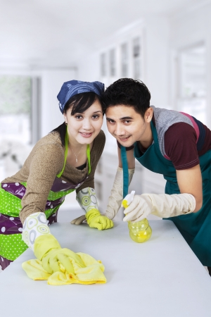 domestic chore: Portrait of asian couple cleaning new home