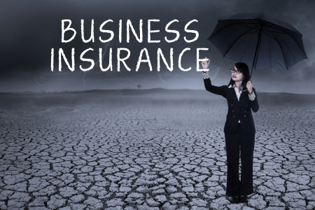 Business woman writing insurance concept on the air. shot outdoors Stock Photo