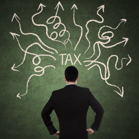 tax bills: Concept of businessman thinking with arrows coming from tax