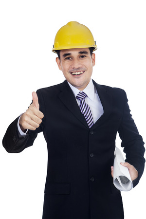 Happy smiling young businessman with thumb up, isolated on white background photo