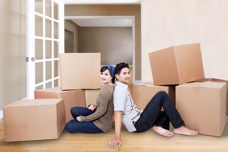 unpacking: Young couple resting from moving into a new home