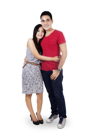 Full portrait of happy couple isolated on white background photo