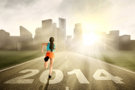 Fitness woman running to a big city through highway photo