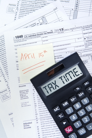 number 15: Tax time concept with an Official USA tax form, calculator, and the day tax april 15