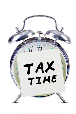 Tax time concept with alarm clock and sticky note photo