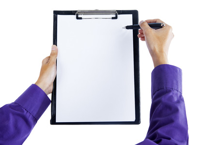 clipboard isolated: Close up of human hand pointing at clipboard with pen
