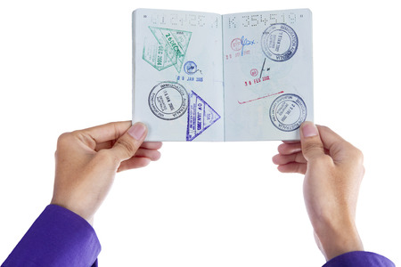Close up of hand showing a passport isolated on white background photo