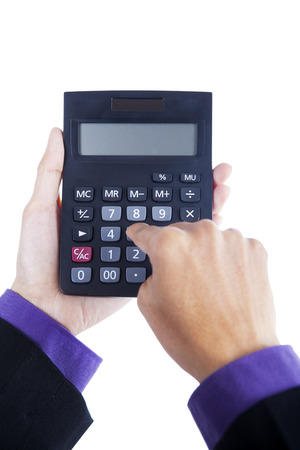 Portrait of businessman hands using calculator photo