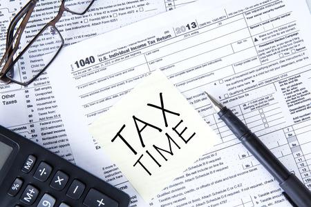 taxation: Tax form, a calculator, a pen on the table