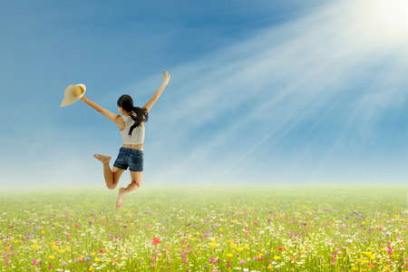 korean girl: Happy beautiful woman is jumping on the park