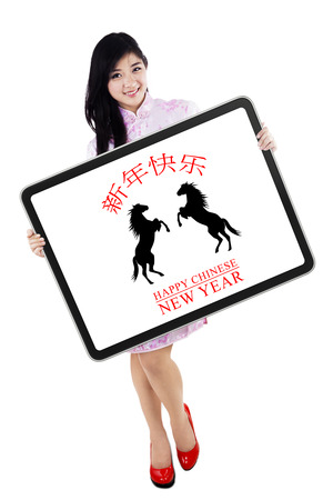 qipao: Attractive young woman showing greeting board of Happy Chinese New Year