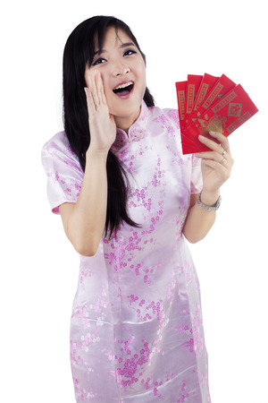Happy young woman yelling to announcing a chinese new year photo