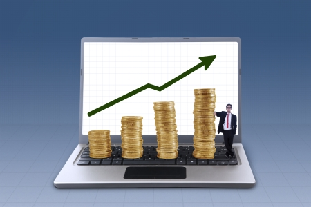 Business manager standing next to profit growth coins chart on blue background photo