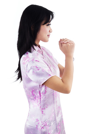 congratulate: Beautiful girl congratulate you a happy Chinese new year on white background