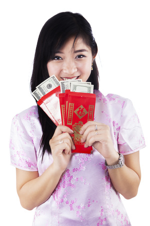 Pretty woman with Chinese traditional dress holding red packet gift photo