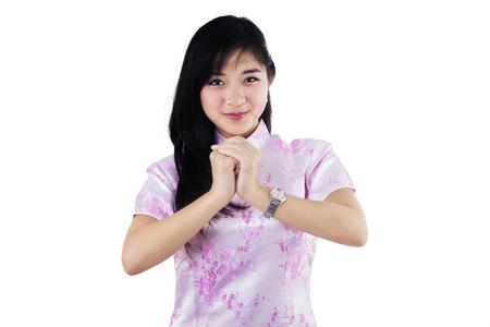 congratulate: Beautiful young asian woman congratulate you a chinese new year