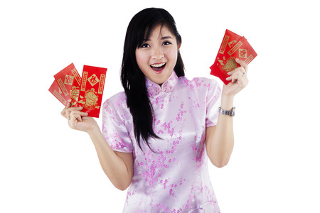 Happy asian woman with red pocket gift - isolated on white background photo