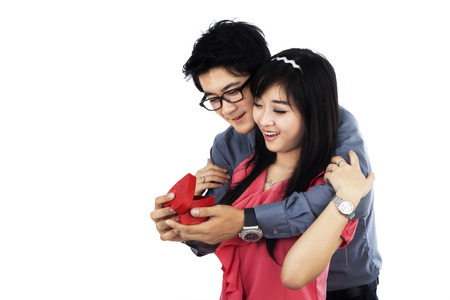 Happy young couple holding a valentine gift box photo