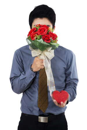 Young man with flowers - isolated on white background photo