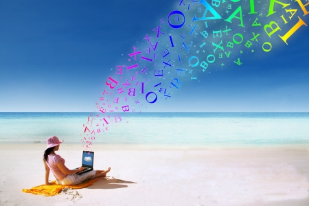 pink hat: Asian woman with pink hat using a laptop on the beach