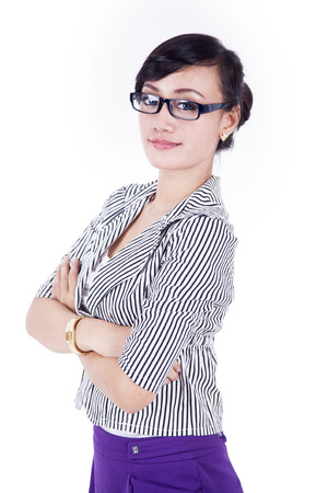 Businesswoman with her arms crossed on white background photo
