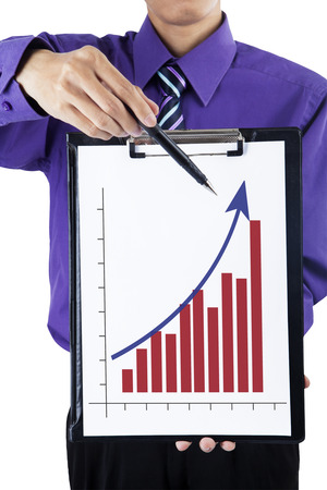 Portrait of businessman showing chart on clipboard photo