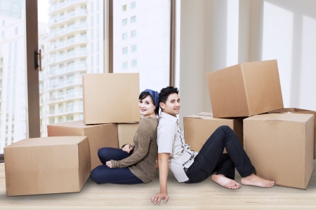 Young couple resting from moving into a new home. photo