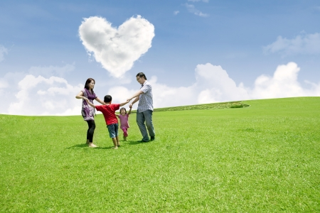Happy family is enjoying valentine in the park photo