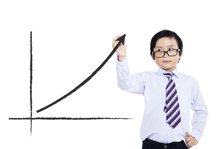 filipino: Little boy drawing statistic arrow on screen with a pen