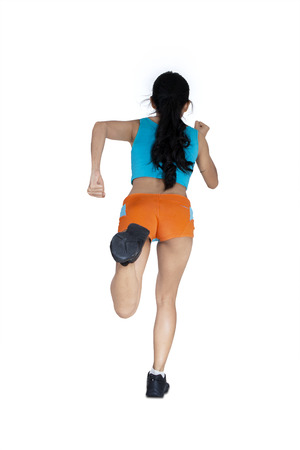Back view of sports woman runs isolated on white background photo