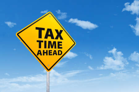 tax returns: Tax time concept with sign post under blue sky