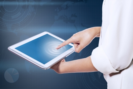 Business woman fingers pointing to the screen on a tablet-pc photo