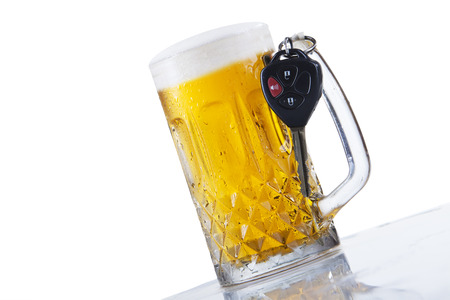 drink responsibly: Concept of Drinking and Driving, beer and car keys Stock Photo