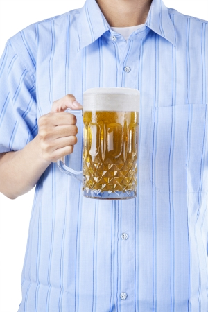 Closeup of a male hand holding a glass of beer photo