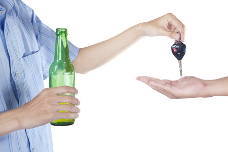 sobriety: Alcoholic giving a car key to someone for driving the car Stock Photo