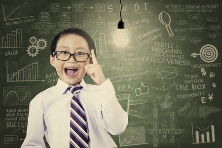 Asian schoolboy has an idea with a light bulb at the classroom photo