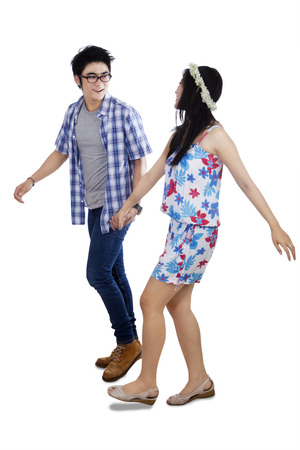 chinese people: Portrait of attractive young couple walking together. isolated on white background