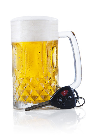 drink responsibly: Concept of Drinking and Driving, beer and a car key Stock Photo