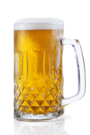 Glass of beer isolated on a white background photo