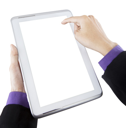 Closeup of businessman hands holding a tablet PC photo
