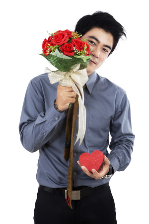 Man with a gift box and a rose. Isolated on white background photo