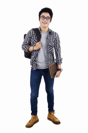 filipino people: Male college student standing on white background