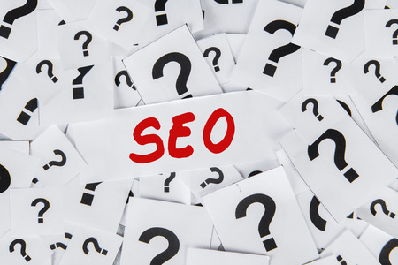 SEO concept with many question mark symbols photo