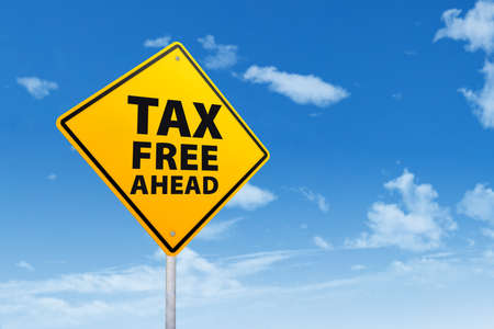 zones: Tax free zone with sign post under blue sky Stock Photo